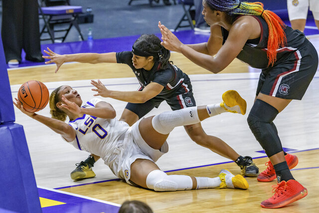 LSU forward Awa Trasi (0) battles for a ball with South Carolina guard Destanni Henderson (3) and South Carolina forward Aliyah Boston (4) during an NCAA basketball game in Baton Rouge, La., Sunday, Jan. 24, 2021. (AP Photo/Matthew Hinton)