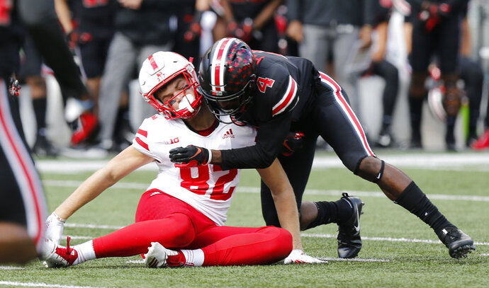 FILE - In this Nov. 3, 2018, file photo, Ohio State defensive back Jordan Fuller tackles Nebraska tight end Kurt Rafdal during the first half of an NCAA college football game Saturday, in Columbus, Ohio. Fuller was ejected from the game for a targeting penalty on the play. The NCAA says the number of enforced targeting penalties in the Football Bowl Subdivision this regular season was the same as in 2017. (AP Photo/Jay LaPrete, File)
