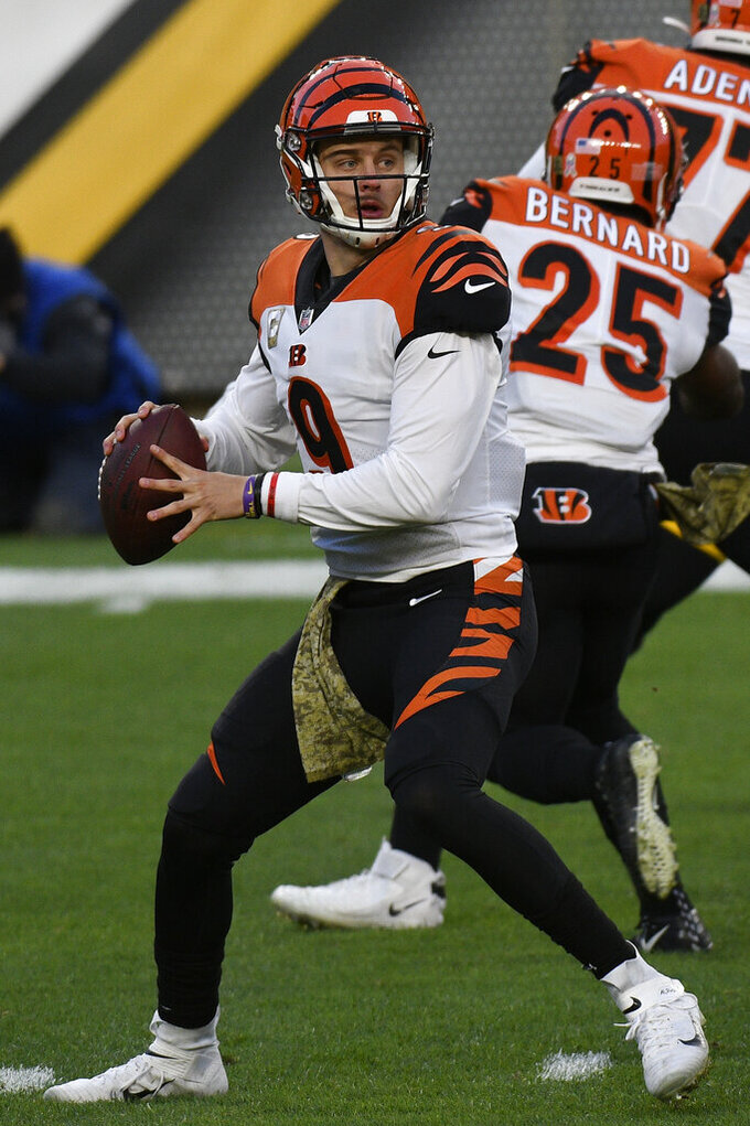 Cincinnati Bengals quarterback Joe Burrow (9) looks to pass during the first half of an NFL football game against the Pittsburgh Steelers in Pittsburgh, Sunday, Nov. 15, 2020. (AP Photo/Don Wright)