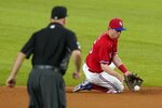 Second base umpire Brian O'Nora watches as Texas Rangers second baseman Nick Solak fields a grounder by Boston Red Sox's Christian Vazquez, who was out at first during the fifth inning of a baseball game in Arlington, Texas, Friday, April 30, 2021. (AP Photo/Tony Gutierrez)