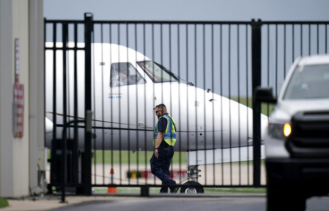 A private plane is readied for Democrats from the Texas Legislature as they arrive by bus to board and head to Washington, D.C., Monday, July 12, 2021, in Austin, Texas. By leaving, Democrats again deny the GOP majority a quorum to pass bills, barely a month after their walkout thwarted the first push for sweeping new voting restrictions in Texas. (AP Photo/Eric Gay)