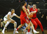 Oregon's Maite Carzola fouls Arizona's Lucia Alonzo, right, as she gets caught between Alonzo and Kat Wright during an NCAA college basketball game in Eugene, Ore., Friday, Jan. 12, 2018. (Brian Davies/The Register-Guard via AP)