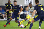 Columbus Crew's Harrison Afful, second from right, dribbles between Nashville SC's Taylor Washington, left, and Dave Romney during the second half of an MLS soccer match Wednesday, July 21, 2021, in Columbus, Ohio. The game ended in a draw. (AP Photo/Jay LaPrete)