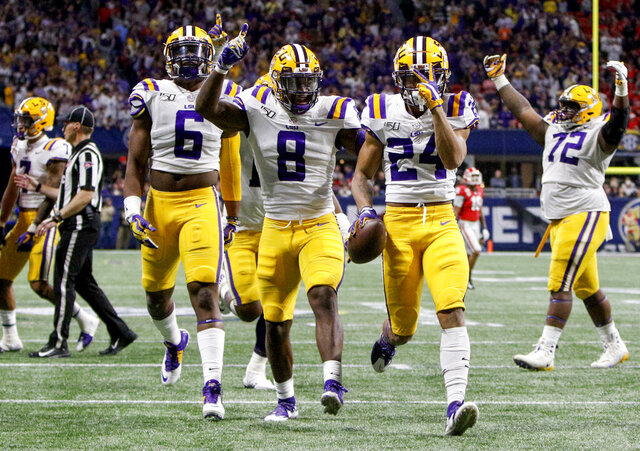 LSU cornerback Derek Stingley Jr. (24) celebrates after his second interception versus Georgia during the Southeastern Conference championship at Mercedes-Benz Stadium on Saturday, Dec. 7, 2019 in Atlanta.(C.B. Schmelter/Chattanooga Times Free Press via AP)