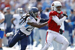 Arizona Cardinals wide receiver DeAndre Hopkins (10) is pushed out of bounds by Tennessee Titans cornerback Jackrabbit Jenkins (20) in the first half of an NFL football game Sunday, Sept. 12, 2021, in Nashville, Tenn. (AP Photo/Wade Payne)