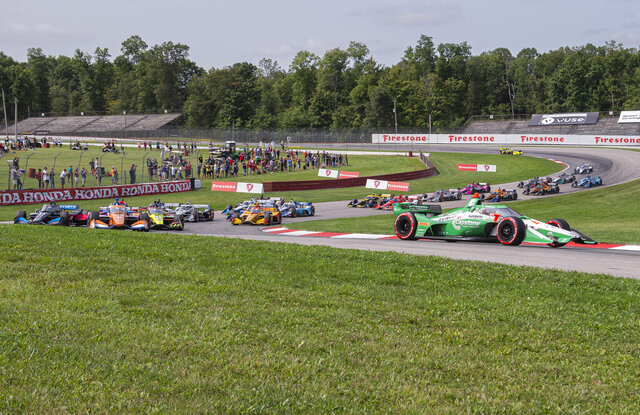 Colton Herta (88) holds the lead early at an IndyCar Series auto race at Mid-Ohio Sports Car Course, Sunday, Sept. 13, 2020, in Lexington, Ohio. (AP Photo/Phil Long)