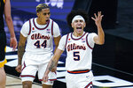 Illinois guard Andre Curbelo (5) celebrates with Adam Miller (44) after scoring following a steal against Iowa in the first half of an NCAA college basketball game at the Big Ten Conference tournament in Indianapolis, Saturday, March 13, 2021. (AP Photo/Michael Conroy)