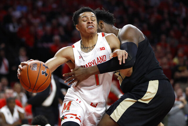 Maryland guard Anthony Cowan Jr. (1) drives against Purdue forward Trevion Williams during the first half of an NCAA college basketball game, Saturday, Jan. 18, 2020, in College Park, Md. (AP Photo/Julio Cortez)