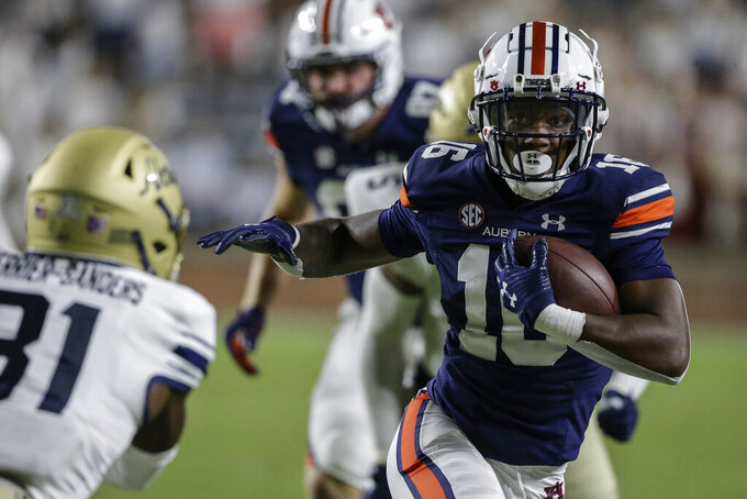 Auburn wide receiver Malcolm Johnson Jr. (16) carries the ball after a reception during the second half of an NCAA college football game against Akron on Saturday, Sept. 4, 2021, in Auburn, Ala. (AP Photo/Butch Dill)