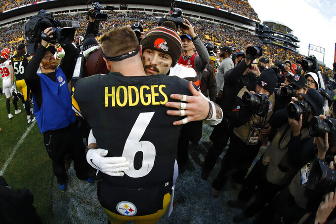 Cleveland Browns quarterback Baker Mayfield, right, shakes Pittsburgh Steelers quarterback Devlin Hodges's hand following a 27-13 Steelers win in an NFL football game in Pittsburgh, Sunday, Dec. 1, 2019. (AP Photo/Gene J. Puskar)