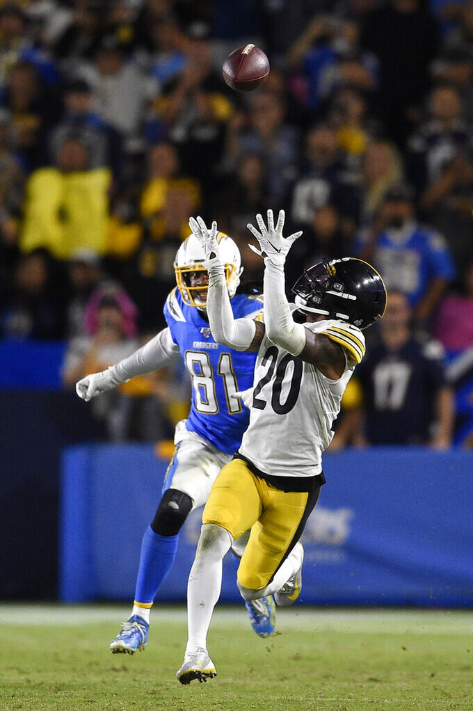 Pittsburgh Steelers cornerback Cameron Sutton, right, catches intercepts a pass intended for Los Angeles Chargers wide receiver Mike Williams during the second half of an NFL football game, Sunday, Oct. 13, 2019, in Carson, Calif. (AP Photo/Kelvin Kuo)
