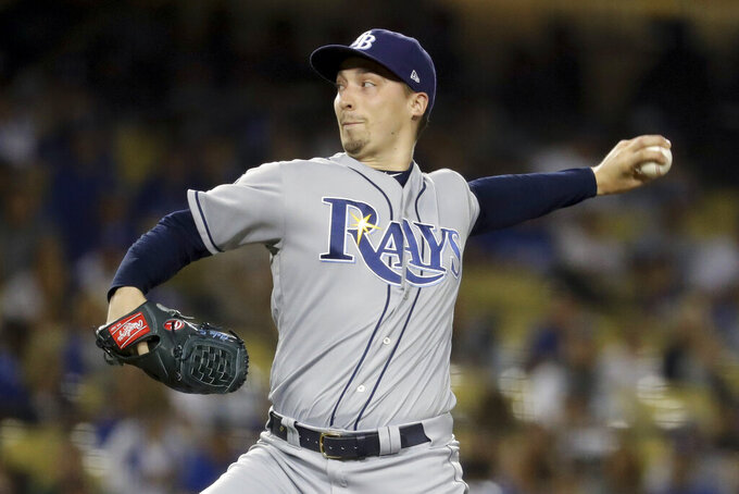 "FILE - In this Sept. 17, 2019, file photo, Tampa Bay Rays starting pitcher Blake Snell throws to a Los Angeles Dodgers batter during the first inning of a baseball game in Los Angeles. Rays All-Star pitcher Blake Snell says he  will not take the mound this year if his pay is cut further, proclaiming: ""I'm not playing unless I get mine."" the 2018 AL Cy Young Award winner said on a Twitch stream Wednesday, May 14 2020. (AP Photo/Chris Carlson, File)"