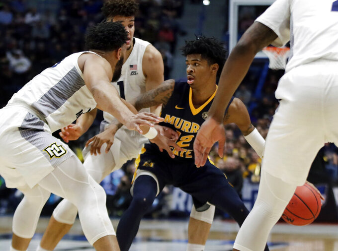 Murray State's Ja Morant (12) looks for room to maneuver with the ball as he is surrounded by Marquette defenders during the first half of a first round men's college basketball game in the NCAA Tournament, Thursday, March 21, 2019, in Hartford, Conn. (AP Photo/Elise Amendola)