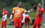 Tampa Bay Buccaneers quarterback Jameis Winston throws the ball during an NFL practice session at Blackheath Rugby Football Club ground in London, Friday, Oct. 11, 2019. The Tampa Bay Buccaneers are preparing for an NFL regular season game against the Carolina Panthers in London on Sunday. (AP Photo/Kirsty Wigglesworth)