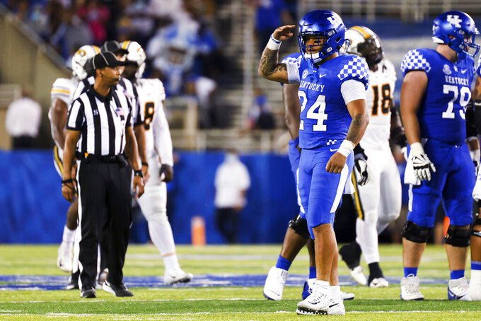 Kentucky running back Chris Rodriguez Jr. (24) salutes to the Missouri bench during the second half of an NCAA college football game in Lexington, Ky., Saturday, Sept. 11, 2021. (AP Photo/Michael Clubb)