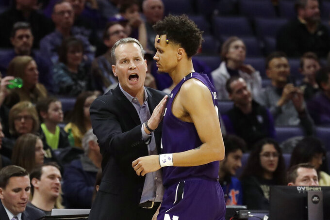 Northwestern head coach Chris Collins, left, talks to forward A.J. Turner during the first half of an NCAA college basketball game against Purdue in Evanston, Ill., Saturday, Feb. 1, 2020. (AP Photo/Nam Y. Huh)