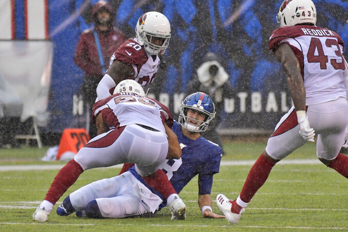 New York Giants quarterback Daniel Jones reacts after sliding during the second half of an NFL football game against the Arizona Cardinals, Sunday, Oct. 20, 2019, in East Rutherford, N.J. (AP Photo/Bill Kostroun)