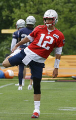 New England Patriots quarterback Tom Brady (12) warms up during an NFL football training camp, Thursday, June 6, 2019, in Foxborough, Mass. (AP Photo/Steven Senne)