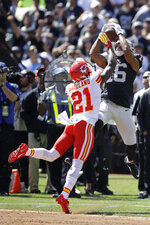 Oakland Raiders wide receiver Tyrell Williams (16) catches a pass as Kansas City Chiefs defensive back Bashaud Breeland (21) looks on during the first half of an NFL football game Sunday, Sept. 15, 2019, in Oakland, Calif. (AP Photo/Ben Margot)