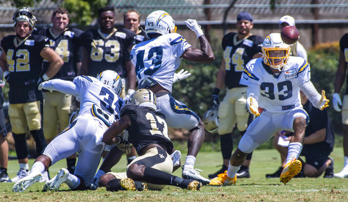 Los Angeles Chargers safety Derwin James Jr., right, catches a tipped pass during the NFL football team's joint practice with the New Orleans Saints on Thursday, Aug. 15, 2019, in Costa Mesa, Calif. (Mark Rightmire/The Orange County Register via AP)
