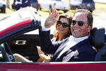 Former New York Mets catcher Mike Piazza and his wife Alicia wave as they drive down newly named Piazza Dr., after a ceremony in front of the Mets spring training facility, Thursday, Jan. 16, 2020, in Port St. Lucie, Fla. (AP Photo/Wilfredo Lee)
