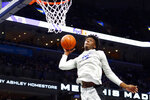 In this Oct. 3, 2019 photo, Memphis freshman center James Wiseman dunks the ball during Memphis Madness in Memphis, Tenn. Michigan State senior guard Cassius Winston, Marquette guard Markus Howard, Louisville junior forward Jordan Nwora, Seton Hall senior guard Myles Powell and Memphis freshman James Wiseman headline The Associated Press 2019-20 preseason All-America team announced Tuesday, Oct. 22, 2019. (Joe Rondone/The Commercial Appeal via AP)