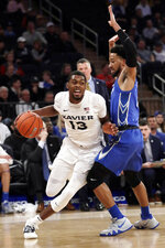 Xavier's Naji Marshall (13) drives past Creighton's Davion Mintz (1) during the first half of an NCAA college basketball game in the Big East men's tournament Thursday, March 14, 2019, in New York. (AP Photo/Frank Franklin II)