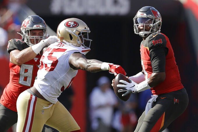 San Francisco 49ers defensive end Dee Ford (55) strips the ball from Tampa Bay Buccaneers quarterback Jameis Winston (3) causing a fumble during the first half an NFL football game, Sunday, Sept. 8, 2019, in Tampa, Fla. The Tampa Bay Buccaneers recovered the fumble. (AP Photo/Chris O'Meara)