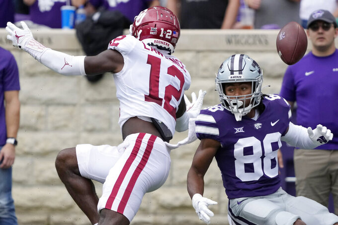 Oklahoma defensive back Key Lawrence (12) knocks the ball away from intended Kansas State wide receiver Phillip Brooks (88) during the first half of an NCAA college football game in Manhattan, Kan., Saturday, Oct. 2 2021. (AP Photo/Orlin Wagner)