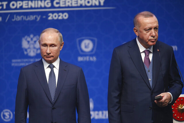 Turkey's President Recep Tayyip Erdogan, right and Russia's President Vladimir Putin, left, attend a ceremony in Istanbul for the inauguration of the TurkStream pipeline, Wednesday, Jan. 8, 2020. The dual natural gas line connecting the countries will open up a new export path for Russian gas into Turkey and Europe, through new and existing lines. (AP Photo/Lefteris Pitarakis)