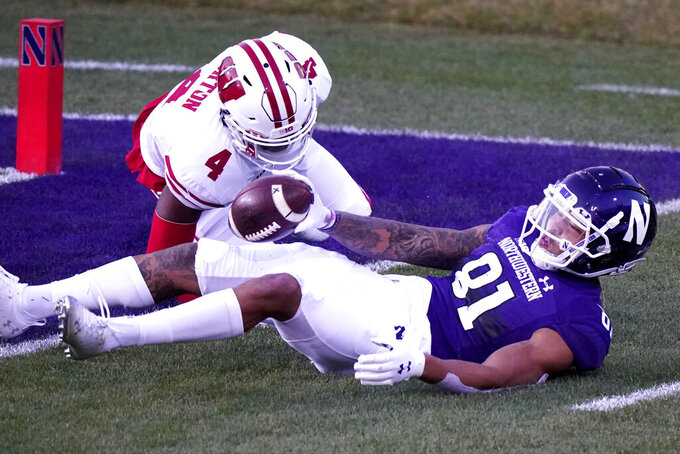 Northwestern wide receiver Ramaud Chiaokhiao-Bowman, right, catches a touchdown pass against Wisconsin cornerback Donte Burton during the first half of an NCAA college football game in Evanston, Ill., Saturday, Nov. 21, 2020. (AP Photo/Nam Y. Huh)