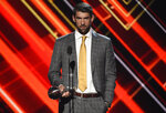 FILE - Michael Phelps accepts the award for best record-breaking performance at the ESPYS on July 12, 2017, in Los Angeles. Olympians including Phelps, Apolo Ohno and Jeremy Bloom are opening up about their mental health struggles in a new sobering documentary about suicide and depression among the world's greatest athletes. Many of the athletes are sharing their pain for the first time in HBO's