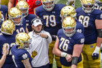 FILE - In this May 1, 2021, file photo, Notre Dame offensive coordinator Tommy Rees talks with players during a timeout in the Blue-Gold NCAA spring football game in South Bend, Ind. The 2021 challenge for Rees is to improve considerably from last season's scoring output of 33.4 points per game. (AP Photo/Robert Franklin, File)