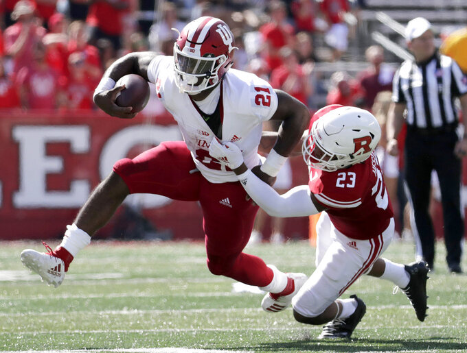 FILE - In this Saturday, Sept. 29, 2018, file photo, Indiana running back Stevie Scott, left, is tackled by Rutgers defensive back Kiy Hester during the first half of an NCAA college football game in Piscataway, N.J. Indiana is an underdog at home to Iowa, but the Hawkeyes are banged up and will be facing a budding star in Stevie Scott and a precision passer in Peyton Ramsey. (AP Photo/Julio Cortez, FIle)