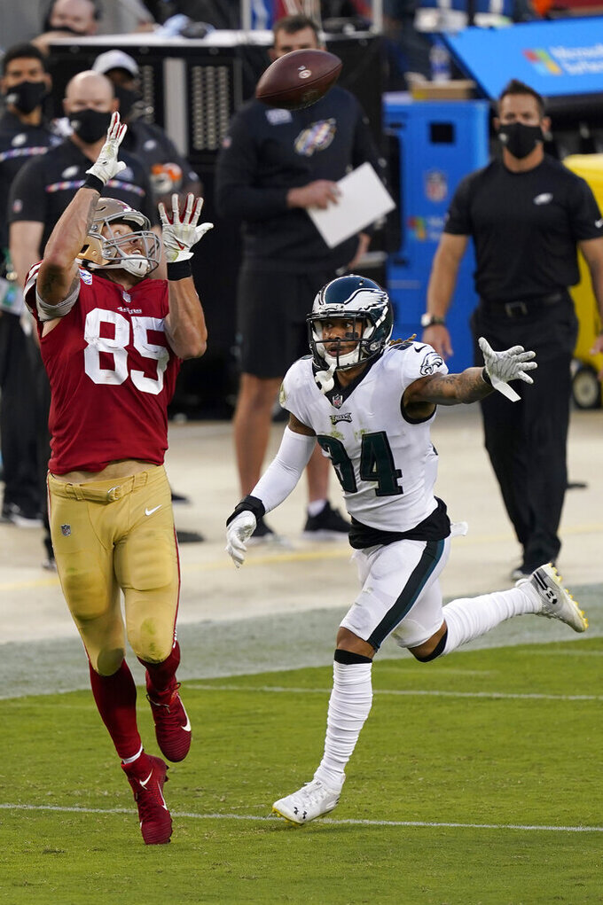 San Francisco 49ers tight end George Kittle (85) catches a pass in front of Philadelphia Eagles cornerback Darius Slay (24) during the first half of an NFL football game in Santa Clara, Calif., Sunday, Oct. 4, 2020. (AP Photo/Tony Avelar)