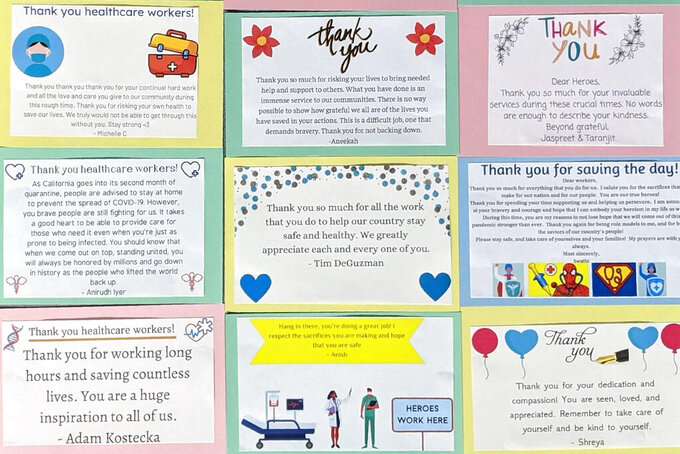 In this Aug. 3, 2020, photo provided by Mantej Singh Lamba, e-cards are printed and prepared for delivery to health care workers, in Fremont, Calif. Siblings Mantej Singh Lamba, 17, and Prabhleen Singh Lamba, 15, started the Cards 4 Covid Heroes initiative in May and have since delivered more than 250 thank-you cards to hospitals in California and Arizona. (Mantej Singh Lamba via AP)