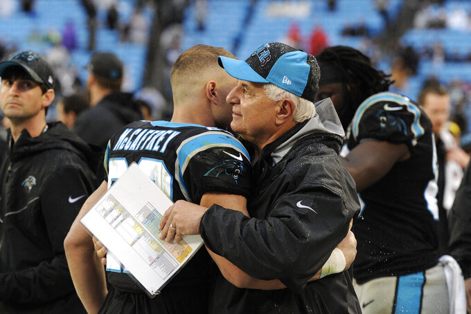 Carolina Panthers running back Christian McCaffrey hugs Panthers running game coordinator John Matsco following an NFL football game against the New Orleans Saints in Charlotte, N.C., Sunday, Dec. 29, 2019. (AP Photo/Mike McCarn)