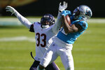 Carolina Panthers wide receiver D.J. Moore catches a pass while Chicago Bears cornerback Jaylon Johnson (33) defends during the second half of an NFL football game in Charlotte, N.C., Sunday, Oct. 18, 2020. (AP Photo/Brian Blanco)