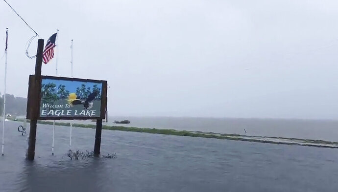 This Sunday, July 14, 2019, image made from a cellphone video provided by the Mississippi Governor's Office  shows the flooded welcome sign at the entrance to Eagle Lake community near Vicksburg, Miss. In a Monday, July 15, posting of the short video on Twitter, Gov. Phil Bryant made reference that