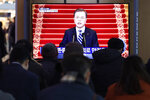 People watch a TV screen showing the live broadcast of South Korean President Moon Jae-in's New Year's speech at the Seoul Railway Station in Seoul, South Korea, Tuesday, Jan. 7, 2020. Moon said he hopes to see North Korean leader Kim Jong Un fulfill a promise to visit the South this year as he called for the rival Koreas to end a prolonged freeze in bilateral relations. (AP Photo/Ahn Young-joon)