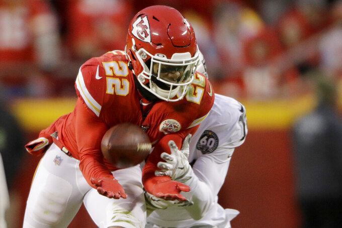 Kansas City Chiefs safety Juan Thornhill (22) intercepts a pass intended for Oakland Raiders wide receiver Keelan Doss behind, and returns it for a touchdown during the first half of an NFL football game in Kansas City, Mo., Sunday, Dec. 1, 2019. (AP Photo/Charlie Riedel)