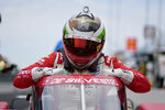 Simona De Silvestro, of Switzerland, climbs out of her car during qualifications for the Indianapolis 500 auto race at Indianapolis Motor Speedway, Saturday, May 22, 2021, in Indianapolis. (AP Photo/Darron Cummings)