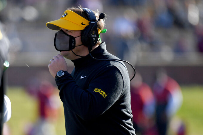 Missouri head coach Eliah Drinkwitz watches from the sidelines during the second half of an NCAA college football game against Arkansas Saturday, Dec. 5, 2020, in Columbia, Mo. (AP Photo/L.G. Patterson)
