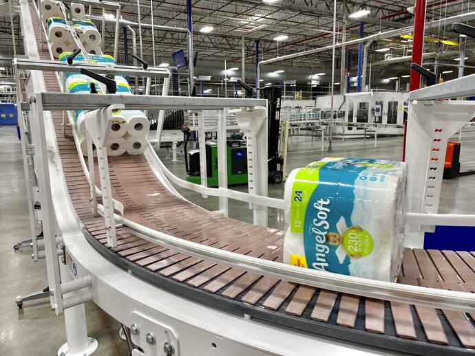 This undated photo provided by Georgia-Pacific shows the production line at the Georgia-Pacific plant in Atlanta.  NCSolutions, a data and consulting firm, said online and in-store U.S. toilet paper sales rose 51% between Feb. 24, 2020 and March 10, as buyers started getting uneasy about the growing number of coronavirus cases. (Georgia-Pacific via AP)