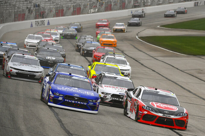 Cole Cluster, left, and Christopher Bell, right, lead at the start of the NASCAR XFinity at Atlanta Motor Speedway, Saturday, Feb. 23, 2019, in Hampton, Ga. (AP Photo/John Amis)