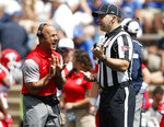 Stony Brook head coach Chuck Priore, left, argues a call with linesman Mark Estermyer in the first half of an NCAA college football game Saturday, Sept. 1, 2018, at Air Force Academy, Colo. (AP Photo/David Zalubowski)