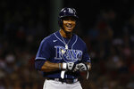 Tampa Bay Rays' Wander Franco smiles while talking to Boston Red Sox players in the dugout after he reached base on a walk during the eighth inning of a baseball game Wednesday, Sept. 8, 2021, at Fenway Park in Boston. (AP Photo/Winslow Townson)