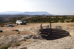 A steel platform covers the entrance to northern Wyoming's Natural Trap Cave near Lovell, Wyo., on  July 8, 2021. Thousands of animals have fallen into the cave and perished over the past 30,000 years, making the site a treasure trove for paleontologists. (Mike Clark/The Billings Gazette via AP)