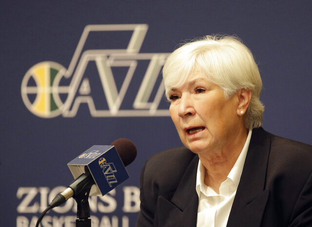 "FILE - In this June 7, 2014, file photo, Utah Jazz owner Gail Miller speaks during a news conference introducing Quin Snyder as the new Utah Jazz head coach, in Salt Lake City. The majority interest of the Utah Jazz is being sold to technology entrepreneur Ryan Smith, a move that when formally approved by the NBA will end the Miller family's 35-year run as owners of the franchise. The Jazz said Wednesday, Oct. 28, 2020, that ""definitive agreements"" have been struck with Smith on the sale of the team, Vivint Arena, the team's G League affiliate and management of a Triple-A baseball club. Part of those agreements call for the team to remain in Utah.  (AP Photo/Rick Bowmer, File)"
