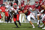 Georgia receiver Kearis Jackson (10) is brought down by Arkansas defender Jordan Silver (48) after a big gain during the first half of an NCAA college football game in Fayetteville, Ark., Saturday, Sept. 26, 2020. (AP Photo/Michael Woods)